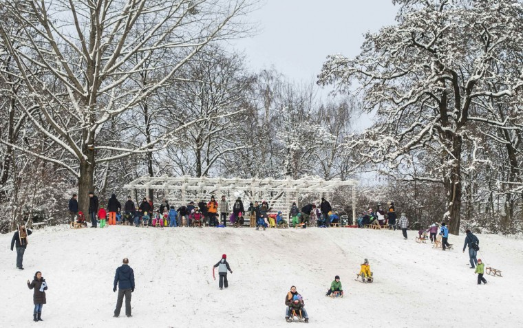 People sledge after snowfalls on a small hill in a park in Berlin December 29, 2014. (Hannibal Hanschke/Reuters)