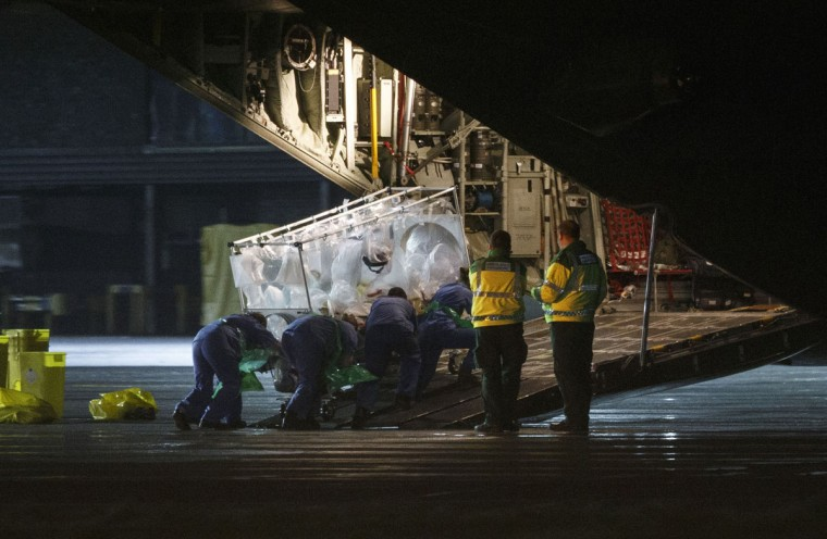 An Ebola patient is put on a Hercules transport plane at Glasgow Airport in Scotland December 30, 2014, to be transported to London. A healthcare worker has been diagnosed with Ebola a day after flying home to Glasgow from Sierra Leone, the Scottish government said on Monday. UK Health Secretary Jeremy Hunt confirmed that the woman would be flown to a specialist unit at Royal Free Hospital in London, local media reported. (Stringer/Reuters)