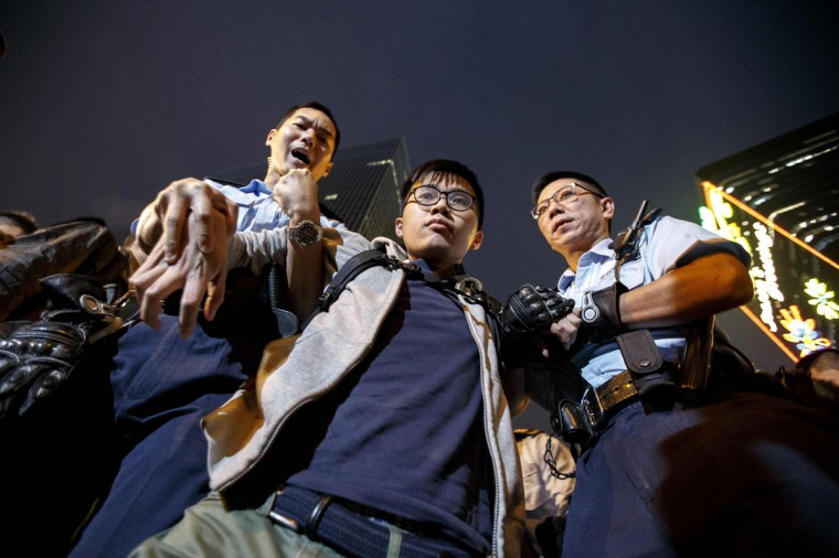A demonstrator is taken away by police officers at an area previously blocked by pro-democracy supporters, outside the government headquarters in Hong Kong, December 11, 2014. Hong Kong authorities started on Thursday clearing the main pro-democracy protest site that has choked roads into the city's most economically and politically important district for more than two months as part of a campaign to demand free elections.(Athit Perawongmetha/Reuters)