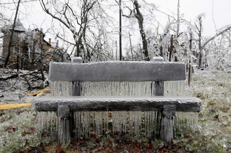 A bench covered in ice on Buda Hills in Budapest, December 3, 2014. Tens of thousand of homes on the outskirts of Budapest went without electricity this week as freezing rain blanketed the area and falling trees cut power lines, Hungary's Disaster Relief Agency said. (Bernadett Szabo/Reuters)