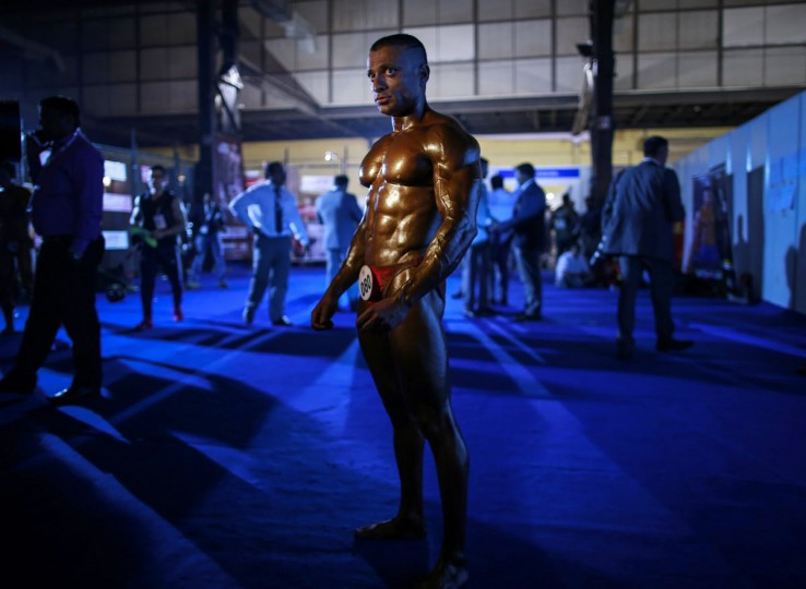 A competitor waits to get onstage during the 6th World Body Building and Physique Sports competition in Mumbai December 9, 2014. More than 400 competitors from 48 countries participated in the competition which was divided into 35 categories, according to a news release. (Danish Siddiqui/Reuters)