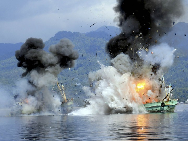 Two foreign flagged fishing boats registered in Papua New Guinea are destroyed by the Indonesian Navy after they were seized earlier for supposedly illegal fishing off the coast of Ambon, Maluku. (Antara Foto/Reuters)