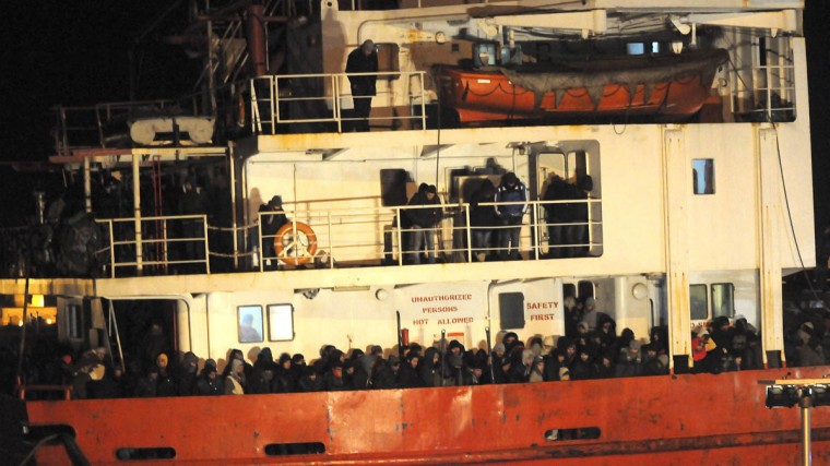 The Blue Sky M cargo ship, carrying an estimated 900 migrants, is seen at the Gallipoli harbour, southern Italy, December 31, 2014. Four migrants were found dead on a cargo ship which was taken to Italy after apparently being abandoned by its crew in Greek waters, the Italian Red Cross said on Wednesday. The Blue Sky M was spotted drifting near the coast of Corfu on Tuesday. Greece sent its navy and coastguard with a military helicopter to the scene in response to an alarm call about a possible incident on the ship and Italian coast guard officials later boarded to check if it could navigate properly. (Reuters photo)