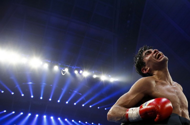 Pedro Guevara of Mexico celebrates after he beat Akira Yaegashi of Japan during their WBC boxing light flyweight title bout in Tokyo December 30, 2014. (Thomas Peter/Reuters)