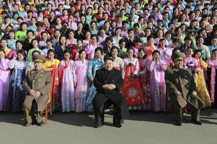 North Korean leader Kim Jong Un poses during a photo session with participants in the Second Meeting of KPA Exemplary Servicemen's Families in this undated photo released by North Korea's Korean Central News Agency (KCNA) in Pyongyang December 9, 2014. (KCNA/Reuters)