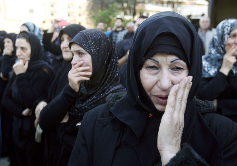 Relatives mourn the death of Lebanese army adjutant Mahmoud Nurredin, who was killed while dismantling an explosive device outside the town of Arsal on the border with Syria on Wednesday, during his funeral in the town of Kafarman, southern Lebanon December 4, 2014. REUTERS/Ali Hashisho