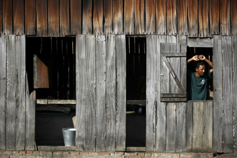A mahout looks through the window of a kitchen in Chitwan, south of Kathmandu December 30, 2014. (Navesh Chitrakar/Reuters)