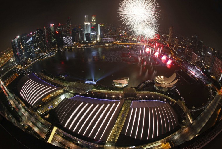 Fireworks light up the sky from a floating installation of 25,000 wishing spheres lining the Marina Bay in the backdrop of the city's financial district during the New Year's Day countdown celebrations in Singapore January 1, 2015. People penned their New Year wishes on these spheres throughout December to be placed in the waters as part of the New Year Day celebrations, marking the city-state's 50th year of independence. REUTERS/Edgar Su