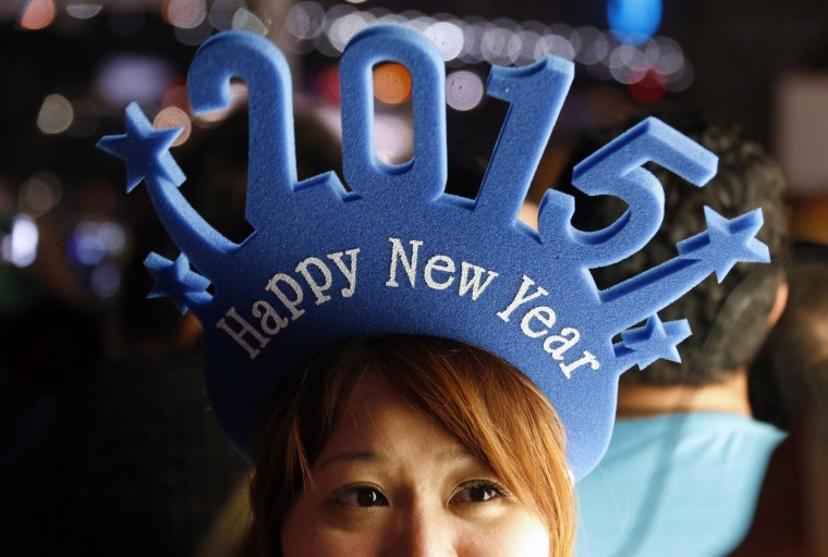 A woman wears a head band displaying 2015 as she waits for the annual New Year fireworks display on Sydney Harbour December 31, 2014. More than 10,000 aerial fireworks, 25,000 shooting comets and 100,000 pyrotechnic effects will be used during this year's Sydney Harbour New Year's Eve show, with an estimated 1.2 million people watching from along the harbour foreshore, local media reported. REUTERS/David Gray