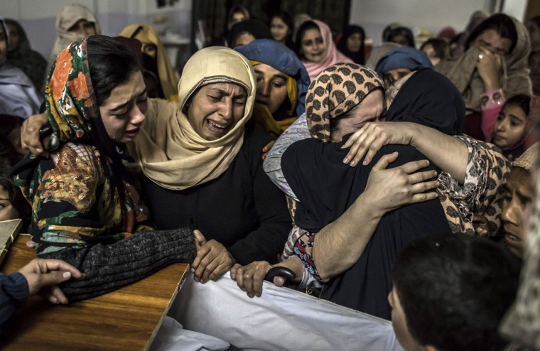 Women mourn their relative Mohammed Ali Khan, 15, a student who was killed during an attack by Taliban gunmen on the Army Public School, at his house in Peshawar December 16, 2014. At least 132 students and nine staff members were killed on Tuesday after Taliban gunmen broke into a school in the Pakistani city of Peshawar and opened fire, witnesses said, in the bloodiest massacre the country has seen for years. (REUTERS/Zohra Bensemra)