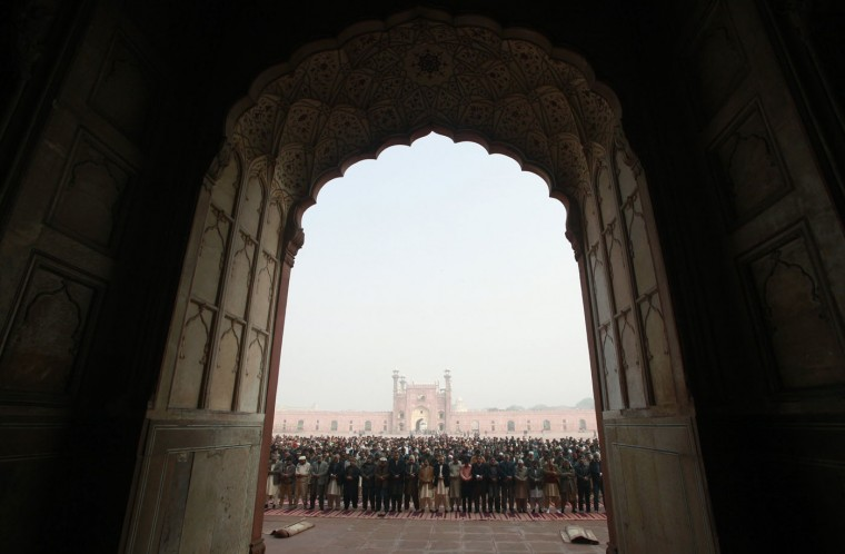 People hold funeral prayers for the victims of the Taliban attack on the Army Public School in Peshawar, at the Badshahi Mosque in Lahore, December 17, 2014. At least 132 students and nine staff members were killed on Tuesday when Taliban gunmen broke into the school and opened fire, witnesses said, in the bloodiest massacre the country has seen for years. REUTERS/Mohsin Raza