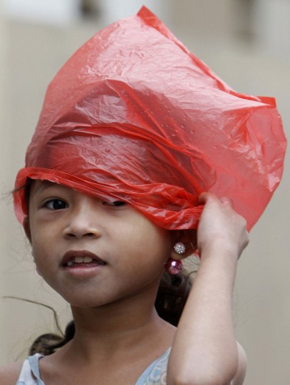 A girl covers her head with plastic bag on her way to an evacuation centre for the coastal community, to shelter from typhoon Hagupit, in Manila, December 8, 2014. Hundreds of thousands of Filipinos began to return to their homes battered by a powerful typhoon at the weekend, but the nation collectively breathed a sigh of relief as a massive evacuation plan appeared to minimize fatalities. (Cheryl Gagalac/Reuters)