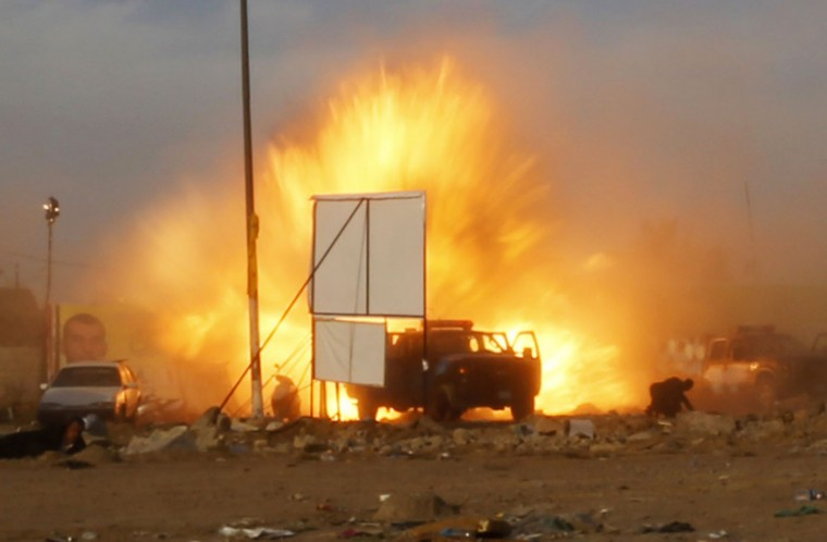 An explosion is seen during a car bomb attack at a rally by militant group, Asaib Ahl Haq (League of the Righteous), to introduce its candidates for elections at a soccer stadium in Baghdad, in this April 25, 2014 file photo. After I was done taking pictures and trying to reach our driver's vehicle to return to the office a powerful blast hit an exit gate. We tried to find a place to hide because we were expecting a secondary explosion and at the same time we were keen to keep documenting the incident. Screams of the wounded, black smoke and bodies surrounded us, while security forces and militia members were shooting in the air to disperse the crowd. I tried to take cover behind anything close by. Along with Reuters cameraman Mahdi Talaat we could only hit the ground and film the event that was taking place in front of us. Then a minibus that was advancing towards the site caught our attention. The car was only a few meters away from our position and heading towards a gate when it blew up. The blazing fire, smoke and the blast's shockwave along with shrapnel raining down on us and the wailing of the wounded made us believe that we were witnessing judgment day. This incident has had a great impact on myself and resulted in raising my awareness and developing a great internal fear of street gatherings, protests and celebrations. Images of the incident are still fresh in my mind and they keep replaying in my head every time I see a large gathering of people and it even haunts me in my sleep at times. - Thaier al-Sudani