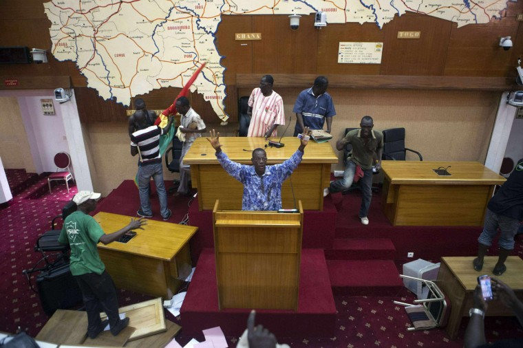 Anti-government protesters take over the parliament building in Ouagadougou, capital of Burkina Faso, in this October 30, 2014 file photo. I'd been following the protesters since the morning. Parliament was set to vote on a law extending the current president's 27-year term and the people were protesting against that. By the time it reached 9 a.m., tens of thousands had marched to the national assembly and physically stopped the vote from taking place. That's when I shot the picture - right at the beginning when the vote was supposed to be held. Inside parliament there was an atmosphere of pure ecstasy. I'm not sure the protesters themselves believed they had made it. Some might look at the images and say 'These are unruly people, they're destroying public buildings'. But the protesters felt they were destroying public buildings that no longer represented the public. They felt they were taking matters into their own hands. - Joe Penney