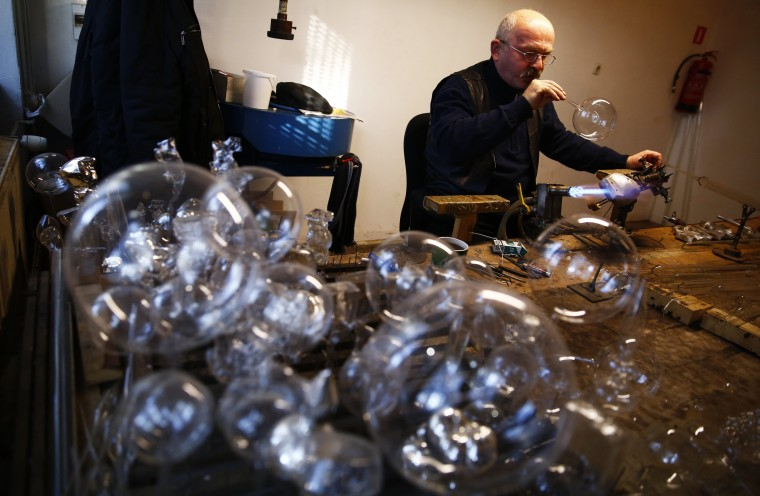 A worker blows a glass bauble at the Silverado manufacture of hand-blown Christmas ornaments in town of Jozefow outside Warsaw December 2, 2014. REUTERS/Kacper Pempel