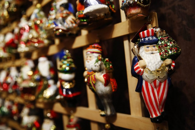 Santa Claus shape glass decorations are displayed at the Silverado manufacture of hand-blown Christmas ornaments in the town of Jozefow outside Warsaw December 2, 2014. REUTERS/Kacper Pempel