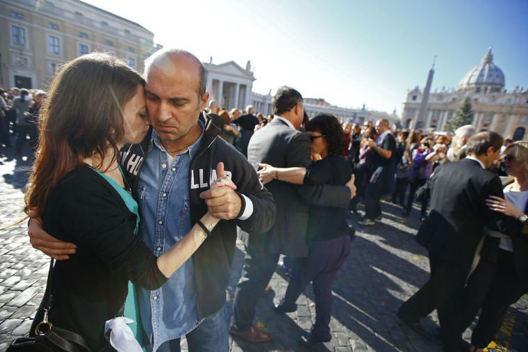 "Couples dance in front of Saint Peter's basilica at the Vatican December 17, 2014. Thousands of people sang ""Happy Birthday"" and danced a mass tango on Wednesday to celebrate the birthday of the first Latin American pope. Argentinian Pope Francis was born in the birthplace of the tango on Dec. 17, 1936. REUTERS/Tony Gentile"