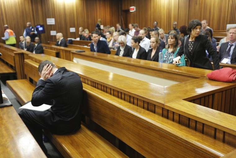 Olympic and Paralympic track star Oscar Pistorius sits in the dock ahead of the second day of his trial for the murder of his girlfriend Reeva Steenkamp at North Gauteng High Court in Pretoria, in this March 4, 2014 file photo. REUTERS/Kim Ludbrook