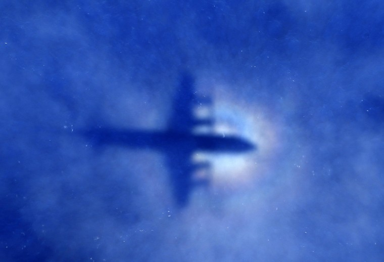 The shadow of a Royal New Zealand Air Force (RNZAF) P3 Orion maritime search aircraft is seen on low-level clouds as it flies over the southern Indian Ocean looking for missing Malaysian Airlines flight MH370, in this March 31, 2014 file photo. REUTERS/Rob Griffith/Pool/Files