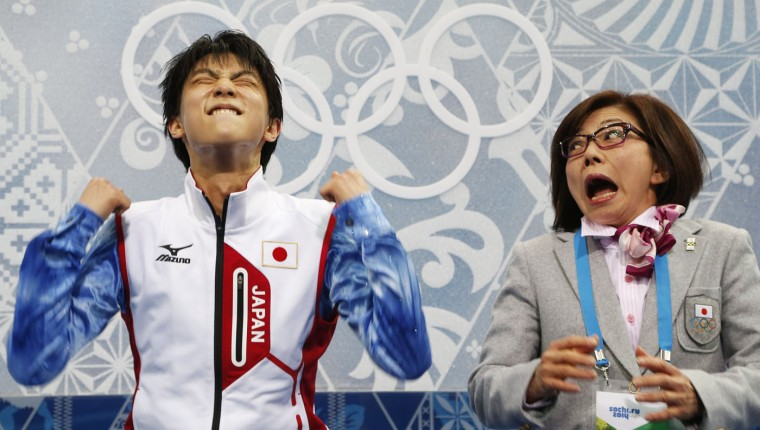 """Japan's Yuzuru Hanyu reacts in the """"kiss and cry"""" area during the Figure Skating Men's Short Program at the Sochi 2014 Winter Olympics, in this February 13, 2014 file photo. REUTERS/Lucy Nicholson/Files"""