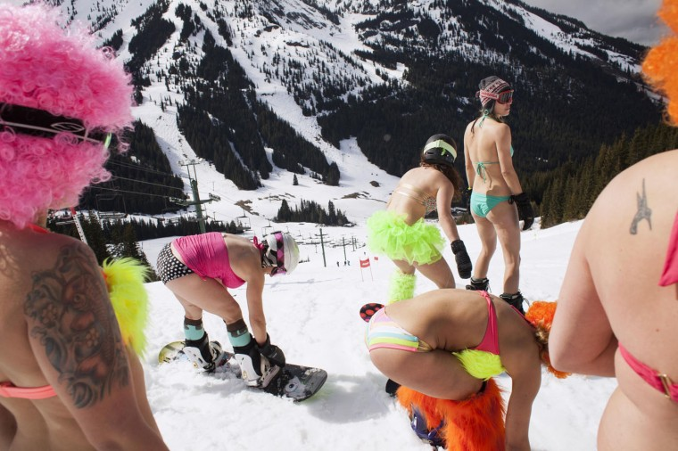 Snowboarders prepare to compete in the Bikini & Board Shorts Downhill at Crystal Mountain, a ski resort near Enumclaw, Washington in this April 19, 2014 file photo. REUTERS/David Ryder/Files