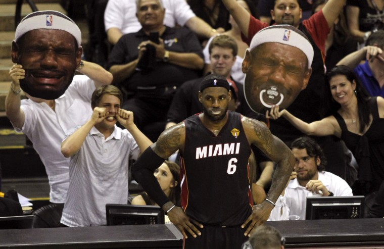 San Antonio Spurs fans taunt Miami Heat's LeBron James during the third quarter in Game 2 of their NBA Finals basketball series in San Antonio, Texas, in this June 8, 2014 file photo. REUTERS/Mike Stone/Files
