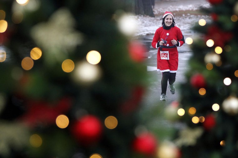 "A costumed participant attends the ""Santa Claus Run"" in Mogosoaia, near Bucharest December 6, 2014. About 100 participants attended the event organized in the benefit of Romanian Association of Pediatric Orthopedists and Traumatologists. (Bogdan Cristel/Reuters)"