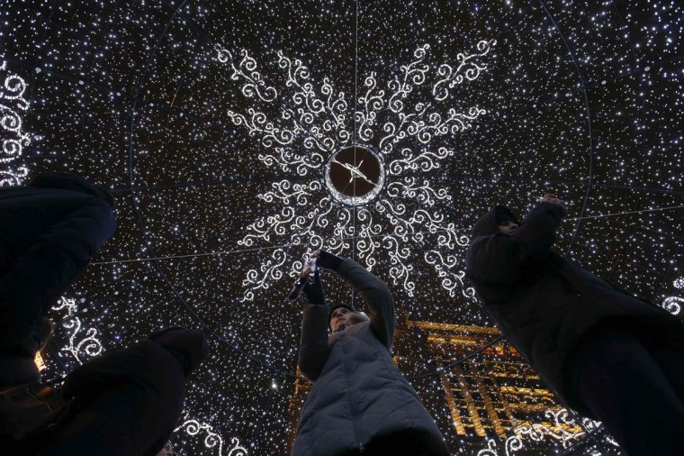 People take pictures inside a giant Christmas ball, part of New Year and Christmas holiday season decorations, in central Moscow, December 15, 2014. The 11.5-metre (38-foot) high ball claims a spot in the Guinness Book of Records as the biggest Christmas toy in the world, according to local media. (Maxim Zmeyev/Reuters)