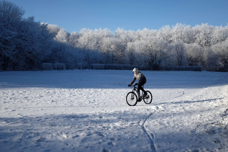 A man rides a bicycle at the city park in Stavropol with the air temperature around minus 8 degrees Celsius (17.6 degrees Fahrenheit) (Eduard Korniyenko/Reuters)