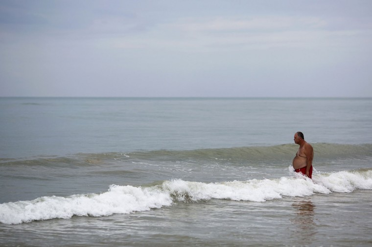 A tourist enters the ocean in Khao Lak, Phang Nga province December 15, 2014.