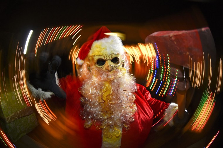 A Zombie Santa is pictured Death Yard Haunted Attraction in Hendersonville, Tennessee December 10, 2014. The Nashville-area haunted house is getting into the Christmas spirit this weekend, with Zombie Santa, his undead elves and a demonic reindeer going on the attack for fun and charity. Picture taken with slow shutter speed and panning motion. (Harrison McClary/Reuters)