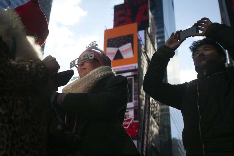 Revelers gather in Times Square as streets are closed in preparation for New Year's Eve celebrations in New York December 31, 2014. REUTERS/Carlo Allegri