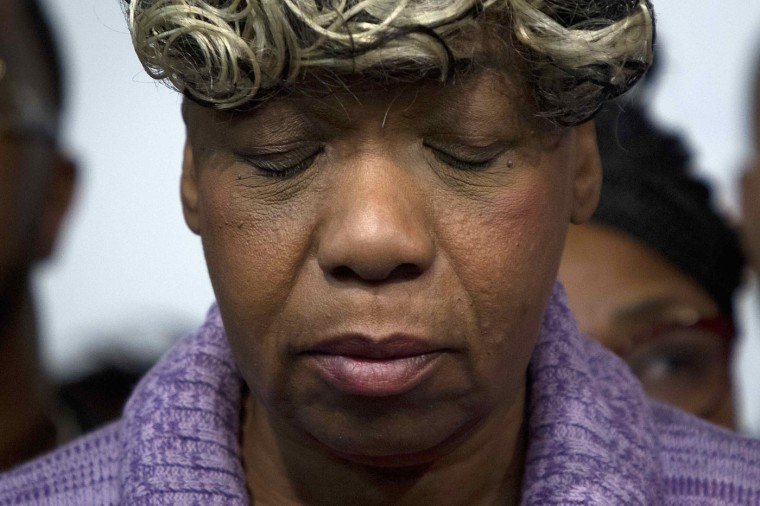 Gwen Carr, mother of the late Eric Garner, listens as civil rights activist Reverend Al Sharpton (not pictured) speaks at the National Action Network in Harlem, New York December 3, 2014. Sharpton on Wednesday called for a protest march in Washington following a New York grand jury decision not to indict a white policeman in the chokehold death of Eric Garner, an unarmed black man. REUTERS/Carlo Allegri