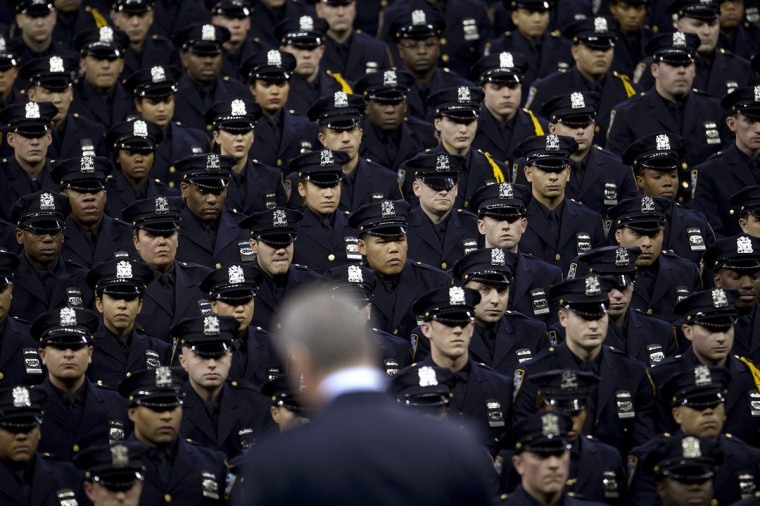 New York Mayor Bill de Blasio speaks from the podium to the New York City Police Academy Graduating class in New York December 29, 2014. Hundreds of officers took part in the ceremony at Madison Square Gardens. (Carlo Allegri/Reuters)