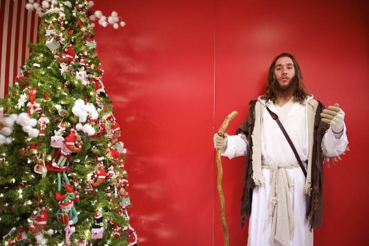 "Michael Grant, 28, ""Philly Jesus,"" poses for a portrait at Macy's department store in Philadelphia, Pennsylvania December 18, 2014. (Mark Makela/Reuters)"