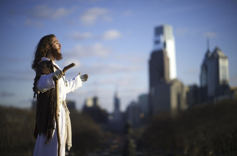 "With the Philadelphia skyline behind him, Michael Grant, 28, ""Philly Jesus,"" looks towards the afternoon sun on December 18, 2014. (Mark Makela/Reuters)"