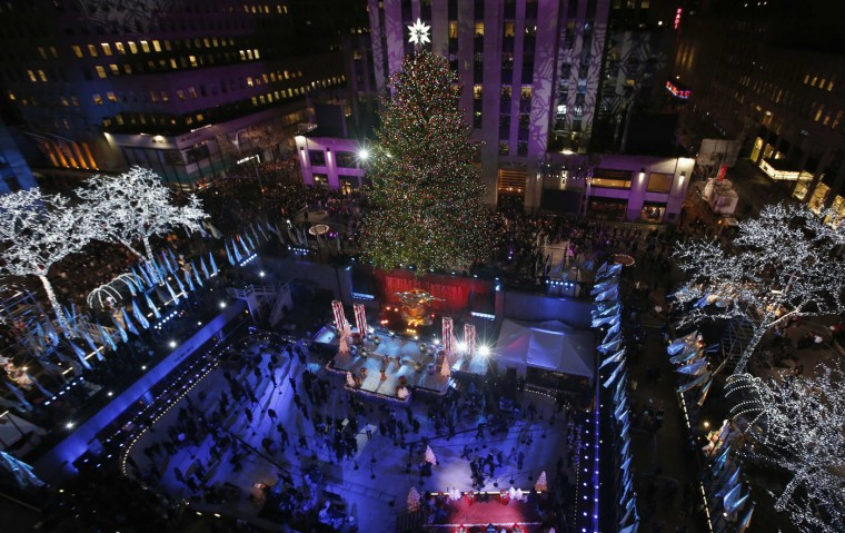 The 82nd Rockefeller Center Christmas tree is seen shortly after being lit at the annual ceremony at Rockefeller Center in midtown Manhattan in New York City, December 3, 2014. REUTERS/Mike Segar