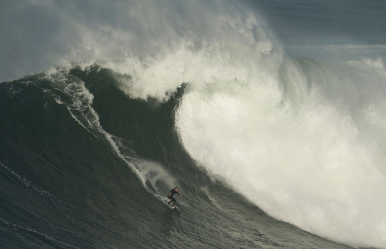 Big-wave surfer Sebastian Steudtner of Germany drops in on a large wave at Praia do Norte, in Nazare November 29, 2014. (REUTERS/Rafael Marchante)