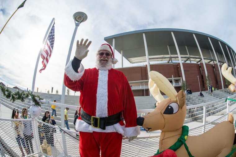 Santa Claus poses for a photo in front of the stadium before the game between the Baylor Bears and the Kansas State Wildcats at McLane Stadium. (Jerome Miron-USA TODAY Sports)