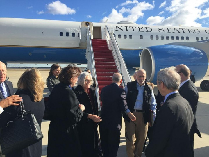 American aid worker Alan Gross (3rd R) disembarks with his wife Judy (4th L) from a U.S. government plane as he arrives at Joint Base Andrews, Maryland outside Washington December 17, 2014 in this photo tweeted by U.S. Sen. Jeff Flake (R-AZ). U.S. President Barack Obama was set to announce a shift in policy toward Cuba on Wednesday and the Associated Press reported the changes would include the opening of an embassy in Cuba and the start of talks to normalize relations. REUTERS/Courtesy the office of Arizona Senator Jeff Flake/Handout