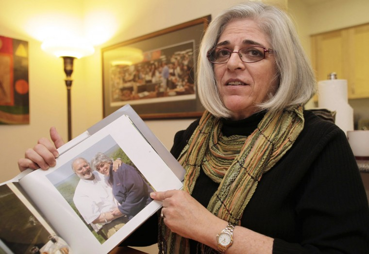 Judy Gross, wife of U.S. aid contractor Alan Gross who is jailed in Cuba, shows their family picture during an interview with Reuters at her apartment in Washington in this file image from October 23, 2010. Cuba has released American aid worker Alan Gross after five years in prison, a U.S. official said on December 17, 2014. Cuba arrested Gross, now 65, on December. 3, 2009, and later convicted the U.S. Agency for International Development (USAID) subcontractor to 15 years in prison for importing banned technology and trying to establish clandestine internet service for Cuban Jews. REUTERS/Yuri Gripas/Files