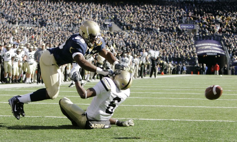 Navy's Irv Spencer (55) breaks up a pass intended for Army's Corey Anderson (6) in the end zone. (AP Photo/Rob Carr)