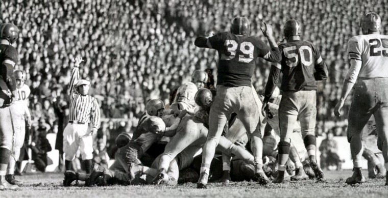 Navy's Dale Scott scores a touchdown against Army. (UM Libraries, Special Collections, News American Photo)