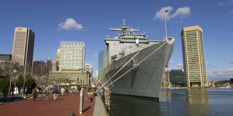 Pedestrians walk past the USS Carter Hall LSD, moored at the Inner Harbor for the Army-Navy football game. (Baltimore Sun photo by John Makely)