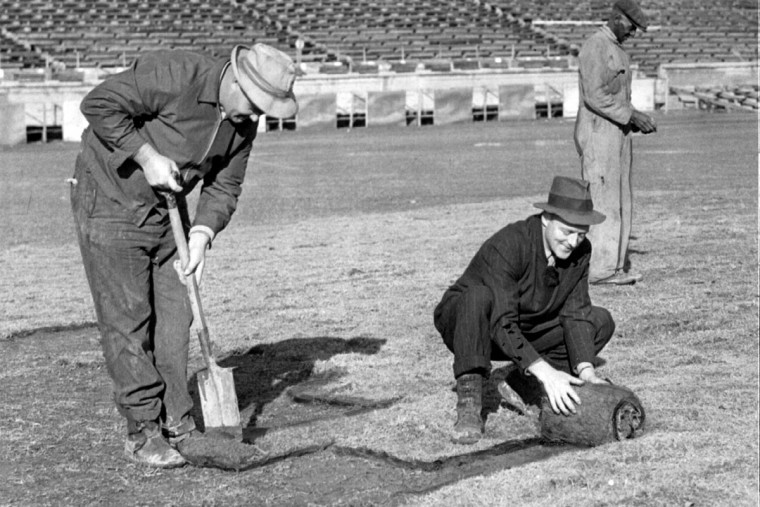From left, Howard McCarty, Richard Carr, and in the background, Melvin Lewis, prepare and re-sod the field for Army-Navy in 1944. (Baltimore Sun file photo)