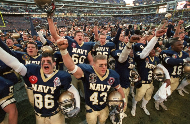 Navy Midshipmen cheer to the stands following their victory over the Army Black Knights in the 101st Army vs Navy game at PSINet Stadium on, Dec. 2, 2000. (Baltimore Sun/Karl Merton Ferron)