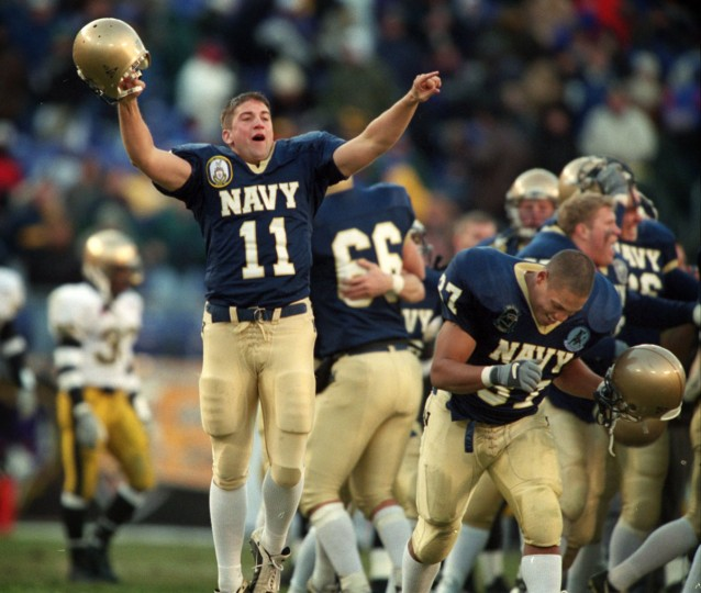 Navy punter Beau Hufstetler (11) and offensive lineman Brian Crosby react as the seconds tick off the clock in the Mids' win over Army at PSINet Stadium on Dec. 2, 2000. (Baltimore Sun/Gene Sweeney Jr)