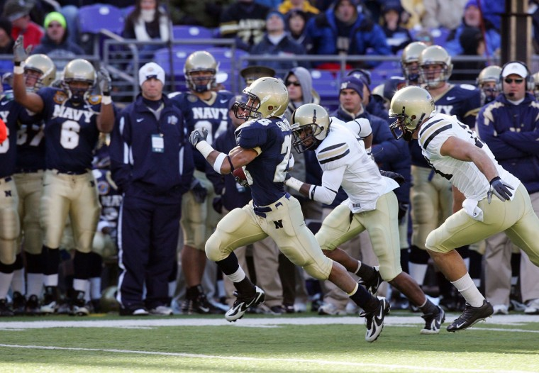 Navy's Zerbin Singleton heads for the end zone against Army. (Photo by Jim McIsaac/Getty Images)