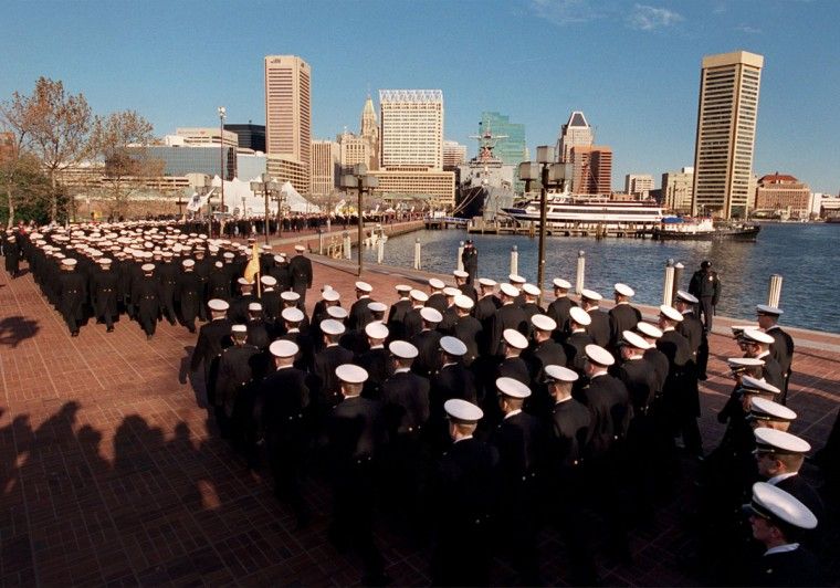 During the March On, a parade of midshipmen march along the Inner Harbor on their way to PSI Net Stadium for the Army-Navy football game in 2000. (Baltimore Sun photo by Linda Coan)