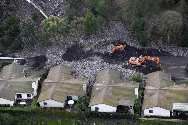 A group of houses are pictured after boulder-strewn rivers of mud swept down hillsides during a winter storm, in Camarillo Springs, California December 12, 2014. (Mario Anzuoni/Reuters photo)